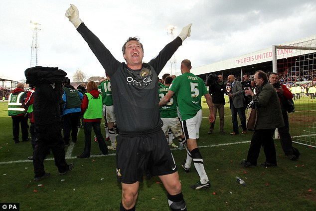 Keeping time: Doncaster goalkeeper Neil Sullivan celebrates clinching the League One title at Brentford