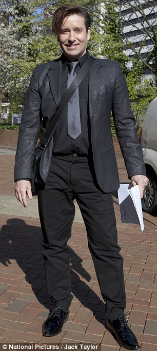Andrew Stone as he arrived at Hammersmith Magistrates Court today. He is accused of assaulting his 25-year-old girlfriend as she wouldn't listen to music with him