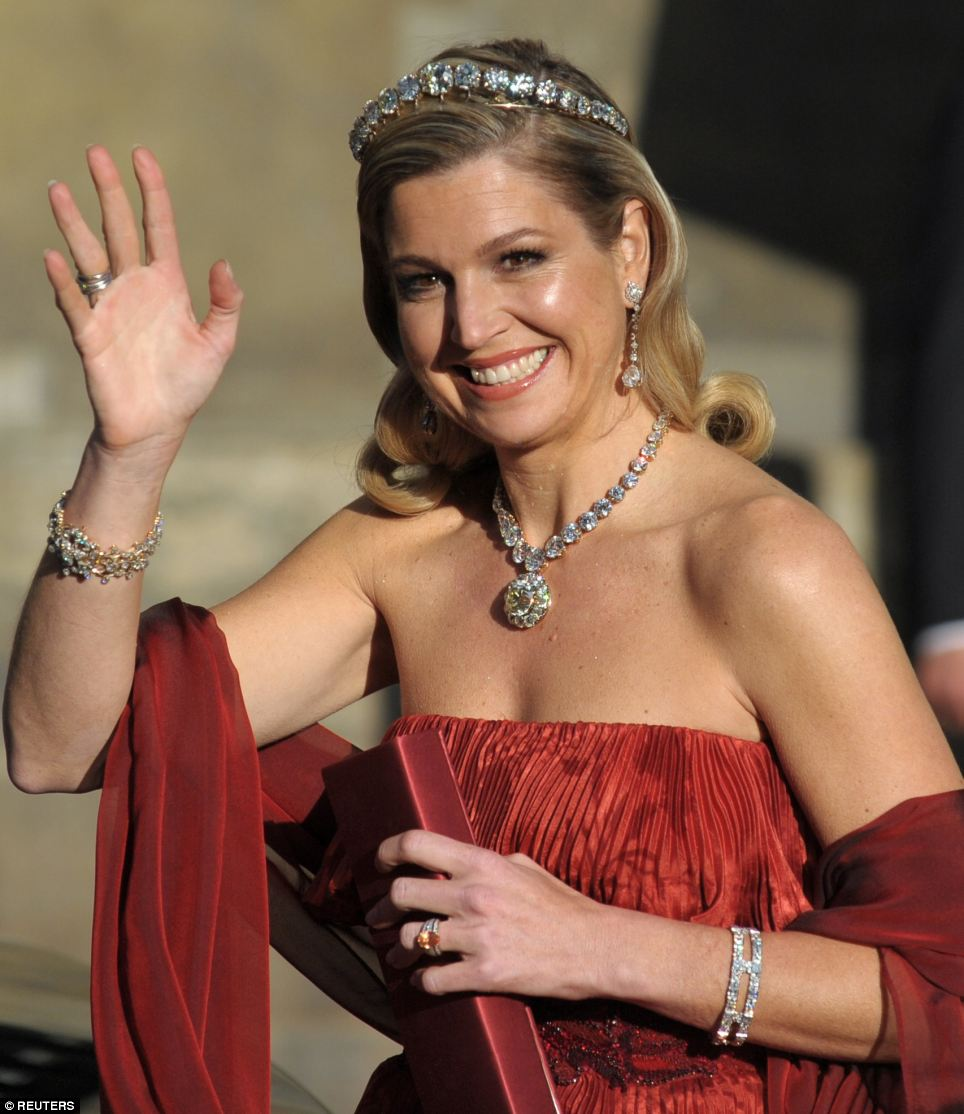 Dutch Crown Princess Maxima waved as she left the Royal Palace before the ceremony
