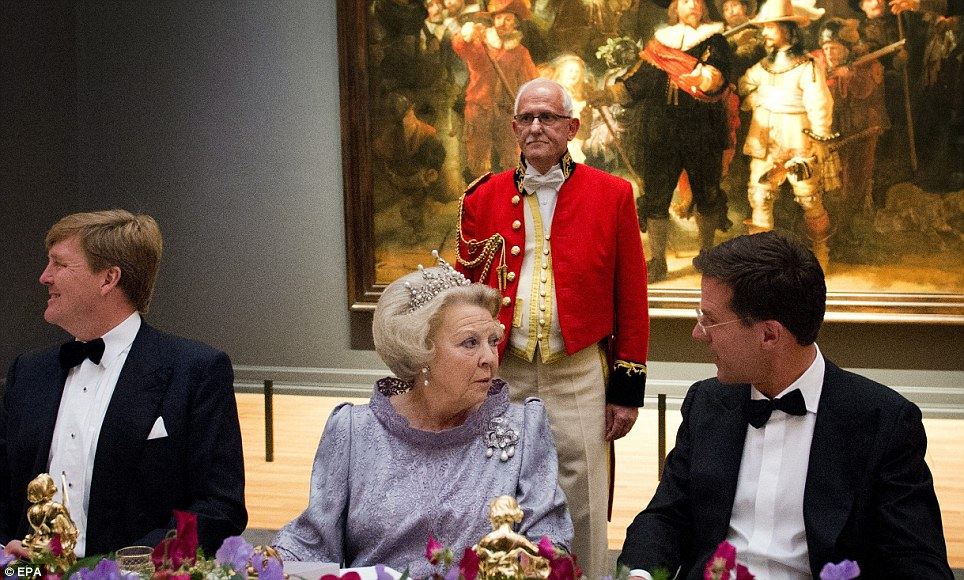 ueen Beatrix was flanked by Dutch Prime Minister Mark Rutte (right) and her eldest son and soon-to-be-king Crown Prince Willem-Alexander