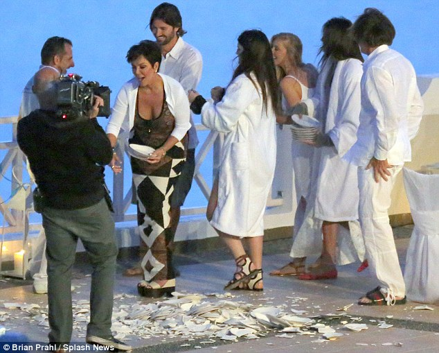 Letting loose: Kris Jenner, surrounded by her family, delighted in smashing white ceramic plates to the ground