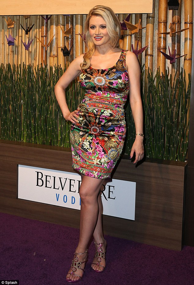 Back to her best: Holly Madison slipped into a colourful patterned and figure-hugging mini dress as she attended the official opening of Nobu Hotel Restaurant and Lounge at Caesars Palace in Las Vegas on Sunday