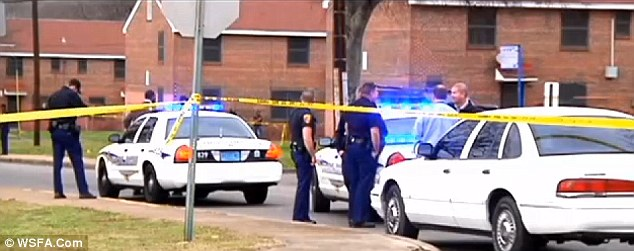 Manhunt: Police in Alabama are asking for the public's help in finding the gunman who fatally shot a woman while she was standing in the doorway of her apartment and holding her 10-day old son