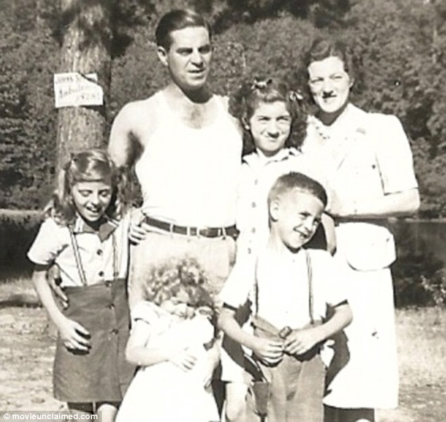 Growing up: Robertson is pictured with his older sister Jean, other siblings and their parents