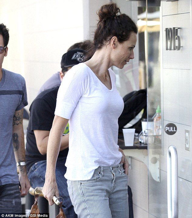 Slim figure: Minnie showed off her lean physique in a simple white T-shirt