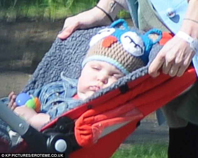 Nap time! Peaches still wore her hospital band as she took her son out for a walk