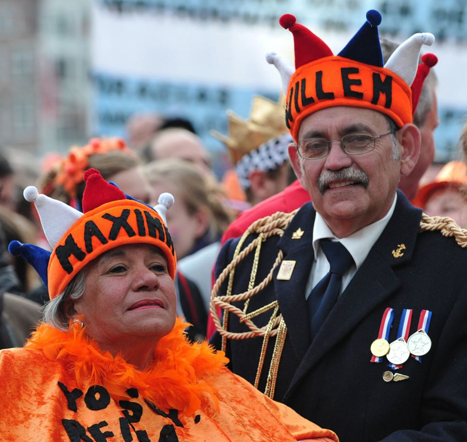 Celebrations: A couple wear hats reading 'Maxima' and 'Willem' as they gather in Dam Square