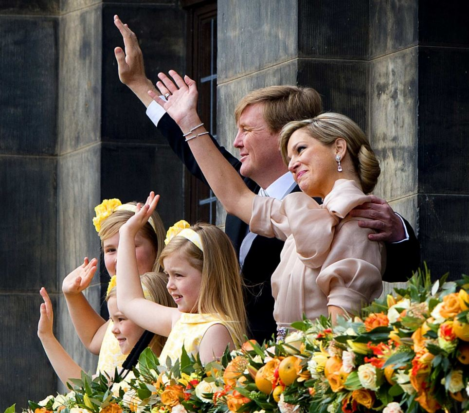 King Willem-Alexander and his wife Queen Maxima accompanied by their daughters Crown Princess Catharina-Amalia (L) Princess Ariane (2nd L) and Princess Alexia wave to crowd