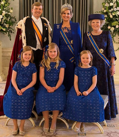 Dutch King Willem-Alexander (back L), Queen Maxima (back C), Royal Highness Princess Beatrix of the Netherlands (back R) with Princesses Alexia, Amalia, and Arianne posing for an official family portrait. Royal Highness Princess Beatrix