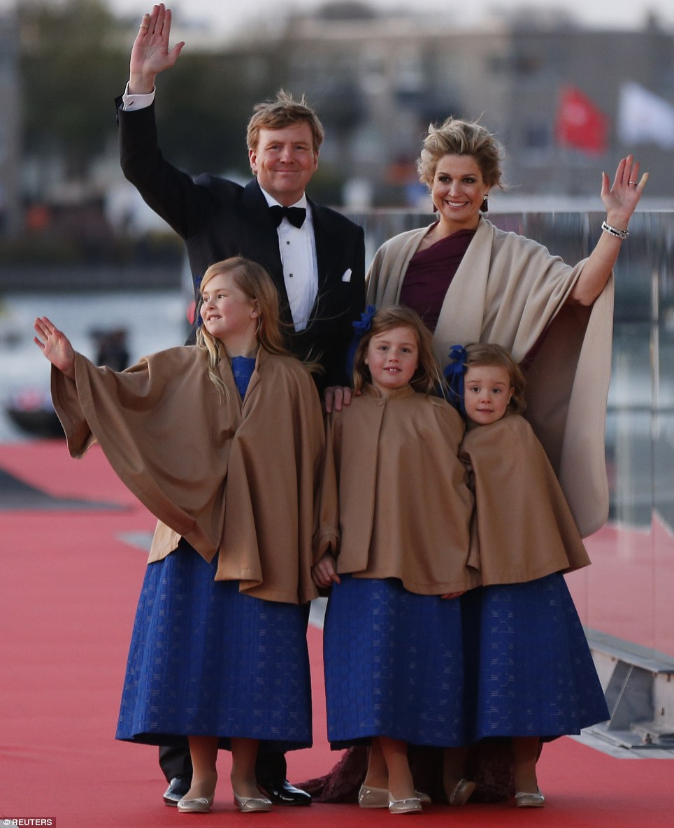 Back on shore: King Willem-Alexander, Queen Maxima, and Catharina-Amalia, left, Alexia, center, and Ariane pose for photographers as they arrive for a party in honour of the new monarch