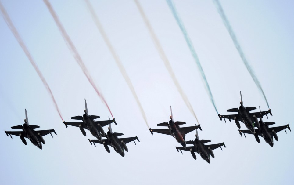 Flying the flag: F-16 fighter jets fly over Amsterdam as part of tonight's festivities