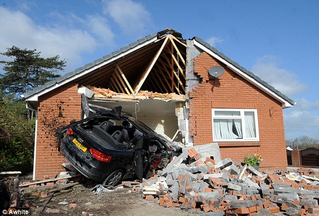 Mrs Heath was in her bedroom when the £25,000 Audi convertible veered off the road and smashed through her wooden gate, down her drive and through the living room wall