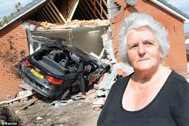 Marianne Heath says she had an 'incredible escape' after a driver passed out at the wheel of his car and crashed through the living room of her bungalow, partially demolishing it