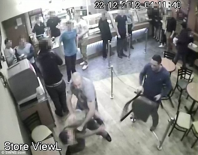 CCTV of the incident of the moment when Oliver Spearey (blue top, un-pixellated face), 29, and Andrew Martin, 36 (grey top, un-pixellated face) attacked a man in a Subway restaurant in Bristol
