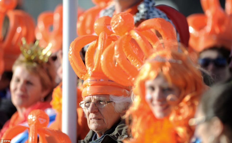 The future's bright: People of all generations dressed from head to toe in orange to join in the celebrations in the Netherlands today