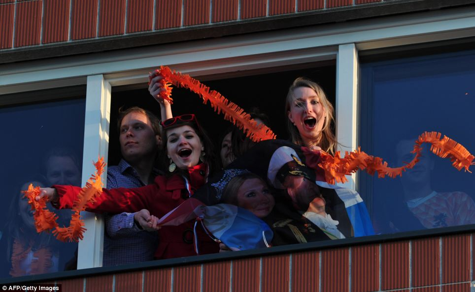 Celebrations: Dutch citizens celebrate the coronation of their new king today, the country's first king since 1890