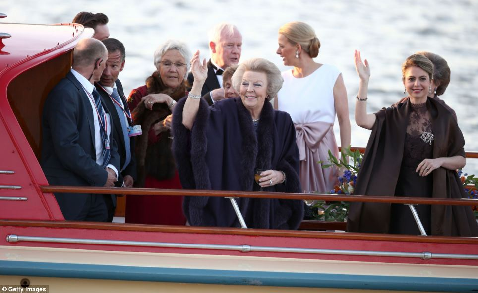 Celebration: Princess Beatrix (centre) is seen during the water pageant to celebrate the inauguration of King Willem Alexander