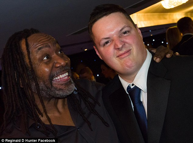 Making an impression: The caption on this picture read, 'Reginald D Hunter's smile beam is deflected by this man's disgust ray'