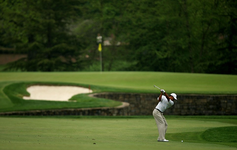 Tiger Woods hits a shot on the seventh hole in 2007