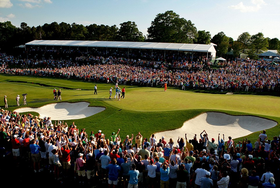 The crowd celebrate Fowler's putt to beat McIlroy and DA Points on the first play-off hole