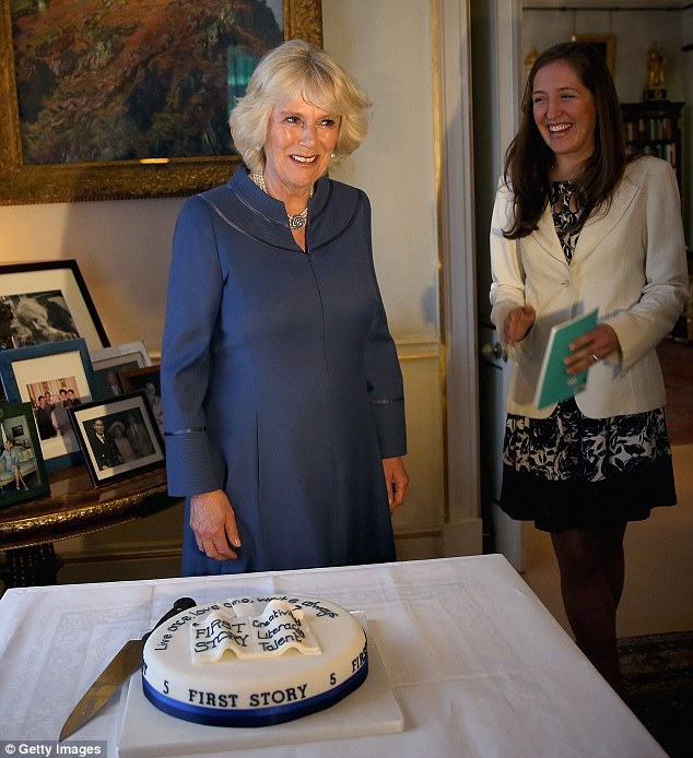 Camilla shares a joke with Katie Waldegrave after cutting a First Story cake at a tea party to celebrate the 5th Anniversary of the charity 'First Story'