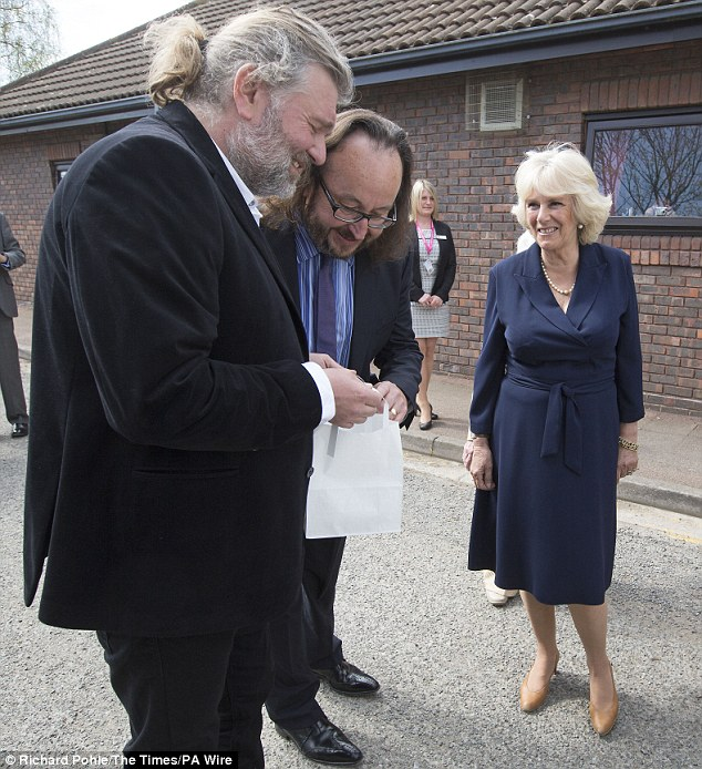 The Duchess of Cornwall walks with celebrity chefs known as the Hairy Bikers', Simon King (left) and David Myers, during her visit to a Community Centre in Cobham, Surrey to highlight the importance of Meals on Wheels