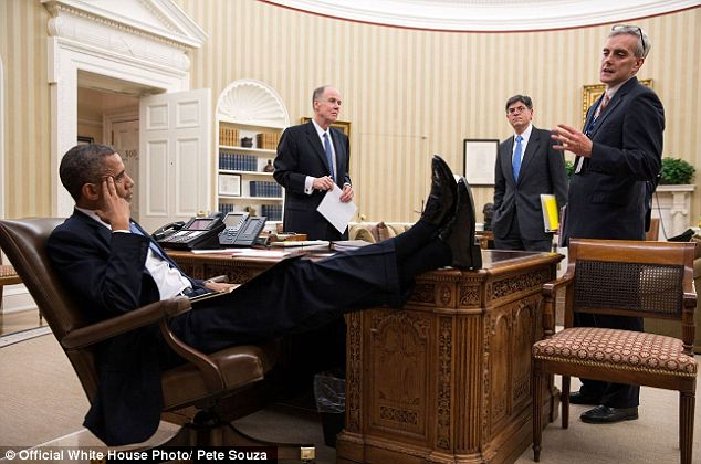 Solemn proceedings: Obama hoofs up on the priceless Resolute desk while discussing matters of state with advisers Tom Donilon, Jack Lew, Denis McDonough in November 2012