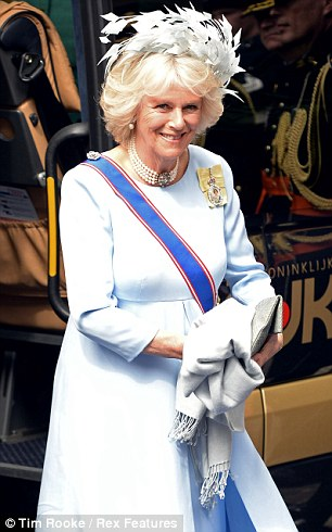 Glamorous: Camilla showed off her glamorous side in a chic pale blue dress with dazzling pearl accessories