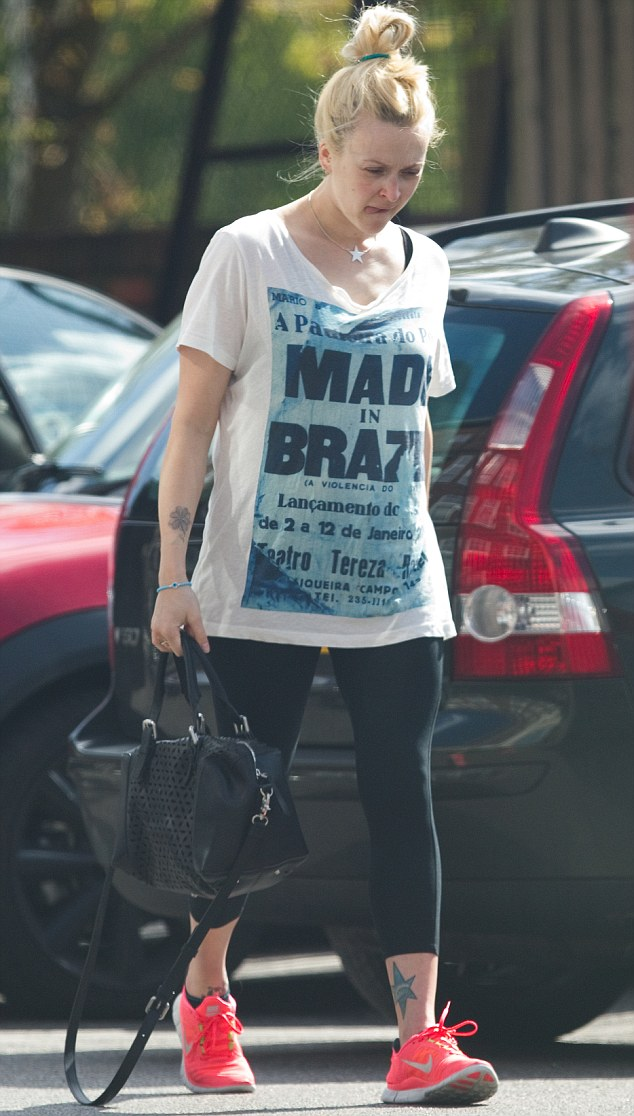 Gym bunny: Fearne wore a pair of leggings and a loose Serge DeNimes top