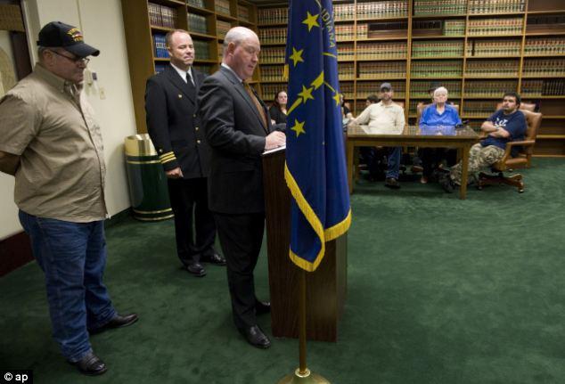 Respect: Indiana Rep. Larry Bucshon, third from left, awards the Purple Heart to the Vietnam War veteran