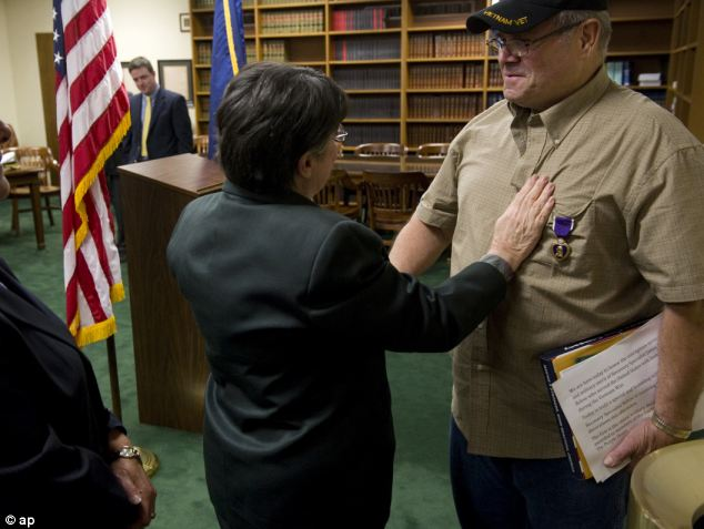 Award: Mr Below was presented with the military decoration during a special afternoon ceremony in the Law Library of the Winfield K. Denton Federal Building, in Evansville, Southwestern Indiana