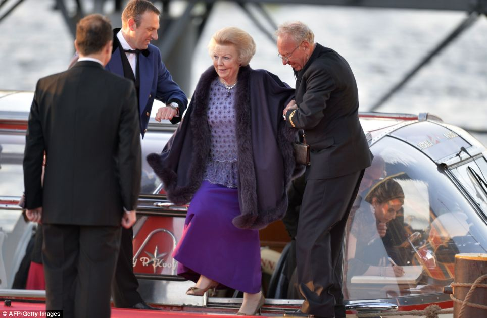 Princess Beatrix of the Netherlands steps out of a boat after taking part  in the water pageant