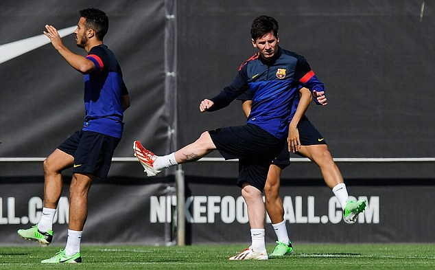 Stretching it: Lionel Messi is struggling with an injury