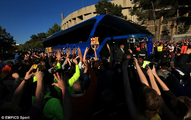 Welcomed: The Barcelona team bus arrives at the Nou Camp surrounded by Barca fans