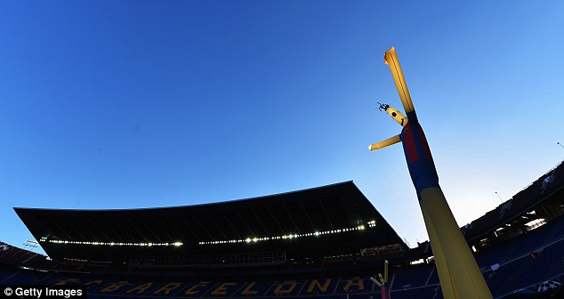 Standing tall: Barcelona's Nou Camp stadium was bathed in sunshine
