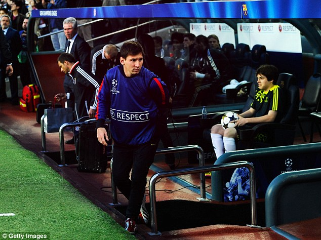 Benched: Lionel Messi takes his place in the Barcelona dugout