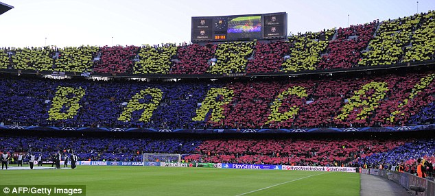 Full support: Barcelona fans unveil a mosaic to support their team