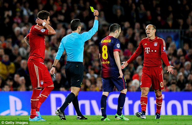 Cautioned: Arjen Robben is booked following a late challenge on Alex Song