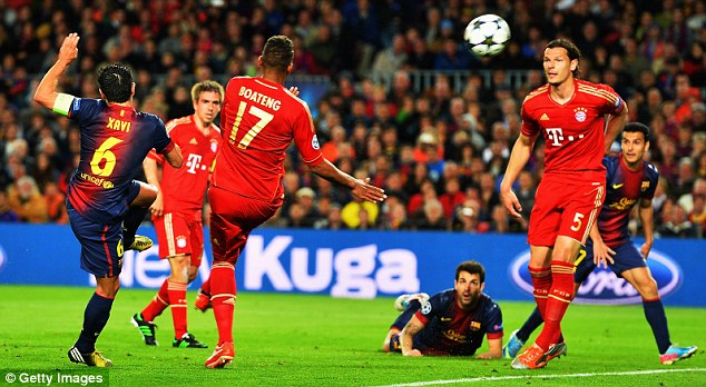 Chance wasted: Xavi volleyed over the bar for Barcelona