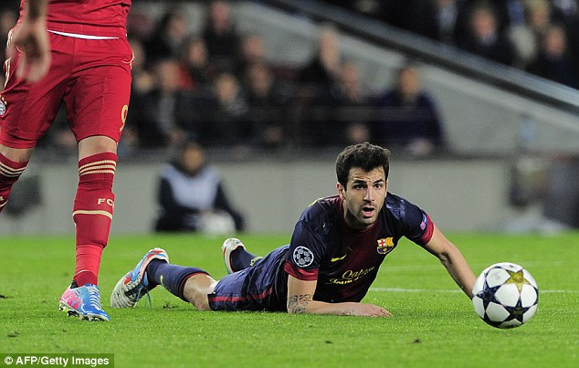 Down and out: Cesc Fabregas looks on after being fouled