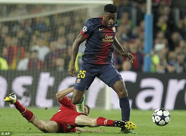 Tackled: Barcelona's Alex Song is challenged by Bayern Munich's Thomas Muller