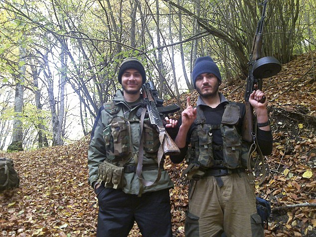 In this undated photo provided by the Dagestani branch of the Federal Security Service, the Canadian, William Plotnikov, (left), poses for a photo