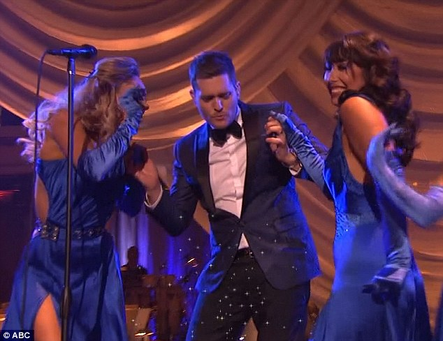 Surrounded: The singer seemed to be enjoying his appearance on the series as he grooved beside a bevy of beautiful dancers