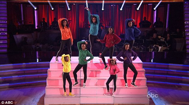 Taking the stage: The girls then stole the spotlight as they revealed a raucous choreographed routine