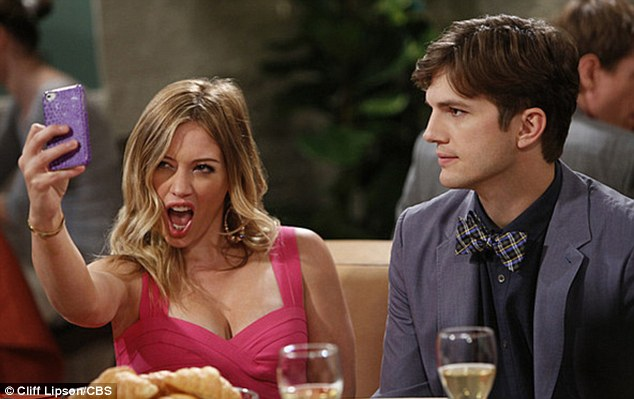 Strike a pose: Hilary Duff plays Stacey alongside Ashton Kutcher as Walden in Two And A Half Men