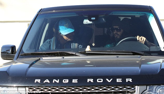 Behind the wheel: Security guard Victor Sneed alleges that Brand, who passed his driving test two years ago, hit him with his Range Rover