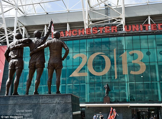 Man Utd post banners on the front of Old Trafford for their 20 Championship win
