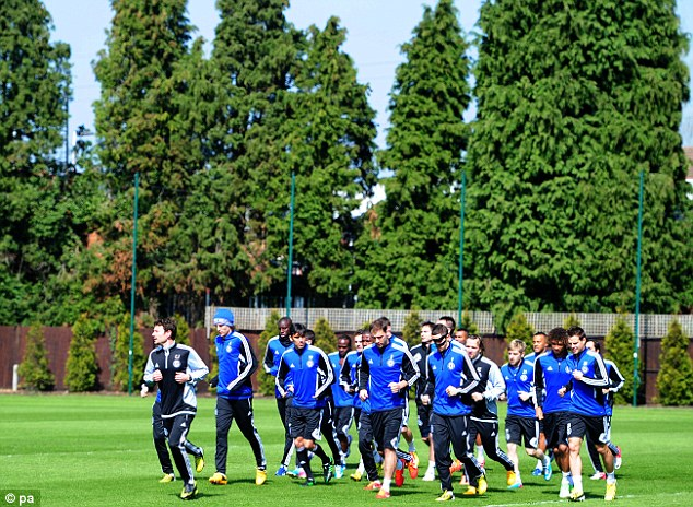 Band of brothers: Chelsea players train at Cobham ahead of the Europa League showdown on Thursday night