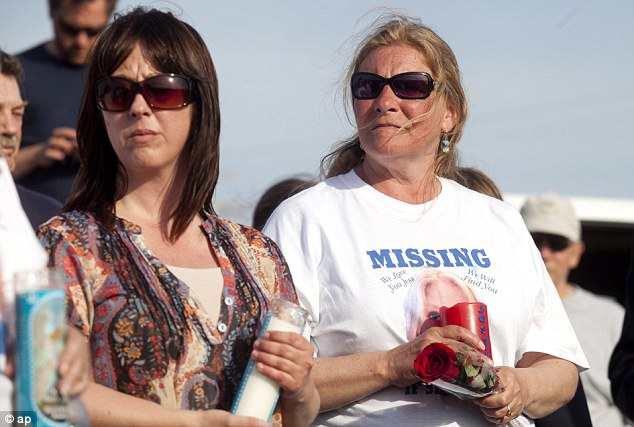 Plea: Shelly Heeringa attended the vigil for her daughter on Tuesday as police released the sketch