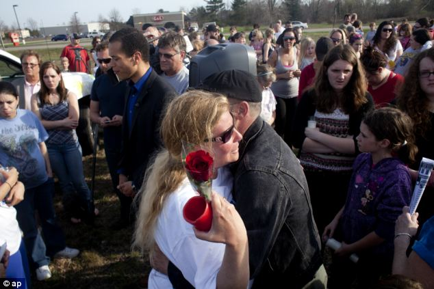 Vigil: A friend hugs Shelly Heeringa, Jessica's mother, during a vigil at Pointes Mall in Norton Shores